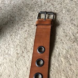 Brown leather belt with hole design
